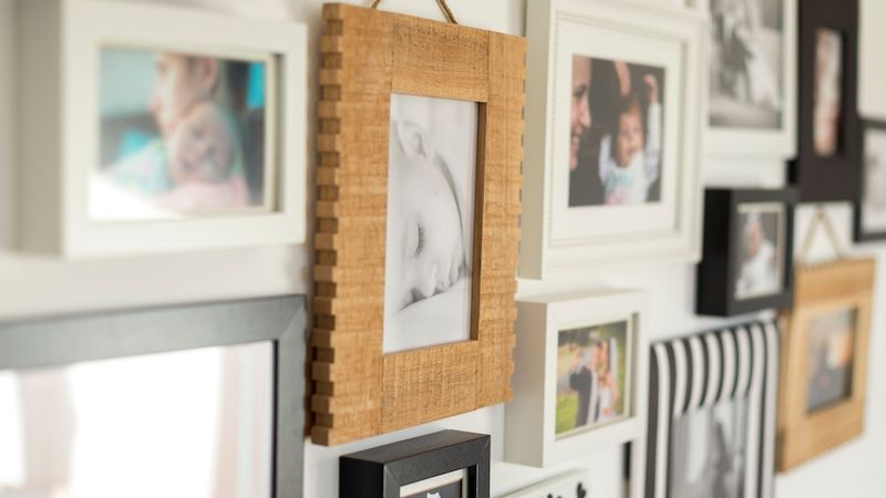 a wall overfilled with family photos
